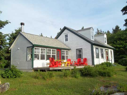 Heritage Cape Cod home after renovation: new dormer windows, new living space in former attic