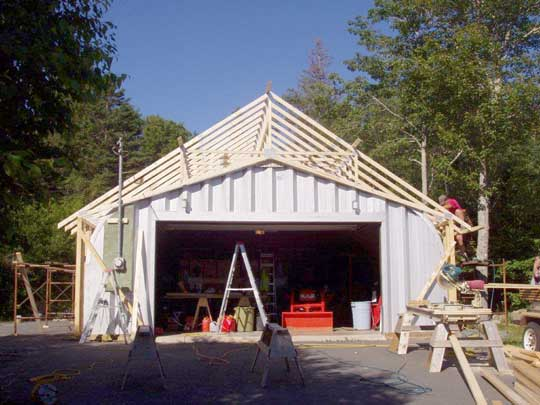 Renovation job to coverup existing Quonset hut with roof trusses and side walls