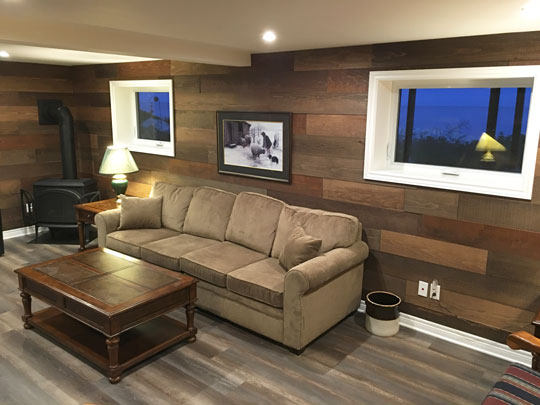 Renovated basement room becomes inviting home entertainment centre. Renovation by Mark Oickle.